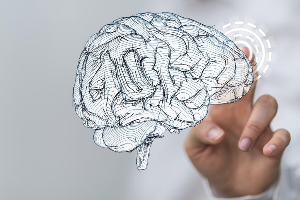 dłoń dotykająca papierowego mózgu jako symbol sztucznej inteligencji